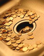 Coins falling down a sink drain