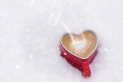 Heart shaped coffee mug sitting in the snow
