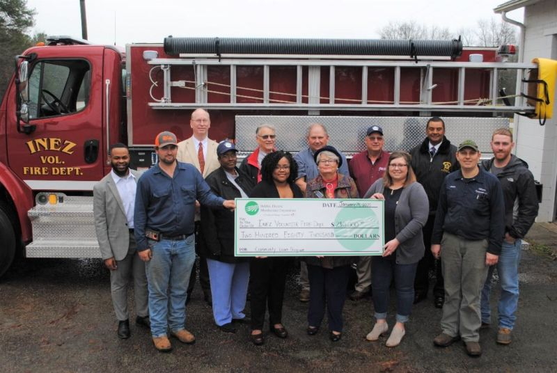 Pictured with the new truck are: (back row) Charles Guerry, Halifax EMC executive vice president; Stan Brothers, HEMC board president; Harry Williams, HEMC board; Macon Robertson, HEMC board; and Warren County Sheriff Johnny Williams. (front row): Emmanuel Gbedee, the Office of Congressman G.K. Butterfield; Alan Sweeney, Inez VFD assistant chief; Robin Williams, HEMC board; Christina Piard, the Office of Congressman G.K. Butterfield; BettyJo Shepheard, the Office of U.S. Senator Richard Burr; Melissa Williams, Inez VFD member; James Williams, Inez VFD secretary; and Christopher Reid, Inez VFD member.