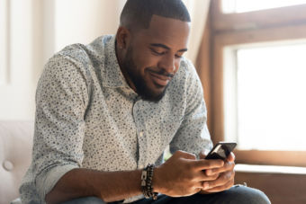 Black man using smartphone